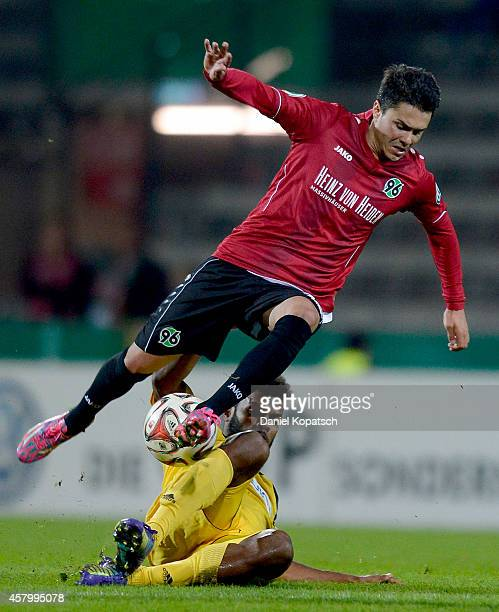 Leonardo Bittencourt of Hannover is challenged by Phil OfosuAyeh of Aalen during the DFB Cup second round match between VfRAalen and Hannover 96 at...