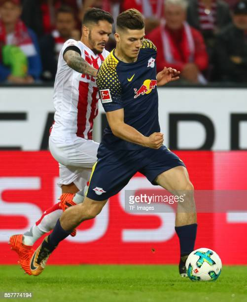 Leonardo Bittencourt of Koeln and Marcel Sabitzer of Leipzig battle for the ball during the Bundesliga match between 1 FC Koeln and RB Leipzig at...