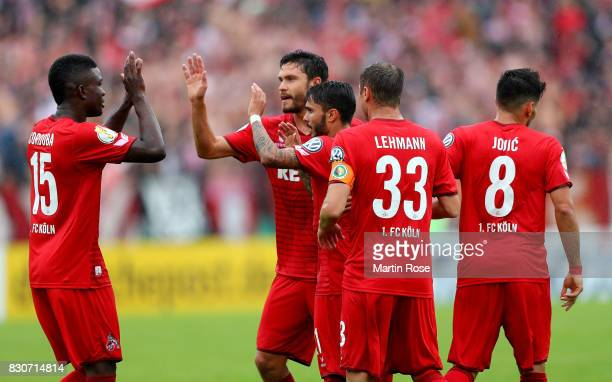 Leonardo Bittencourt of Koeln celebrate with his team mates after he scores the opening goal during the DFB Cup first round match between Leher TS...