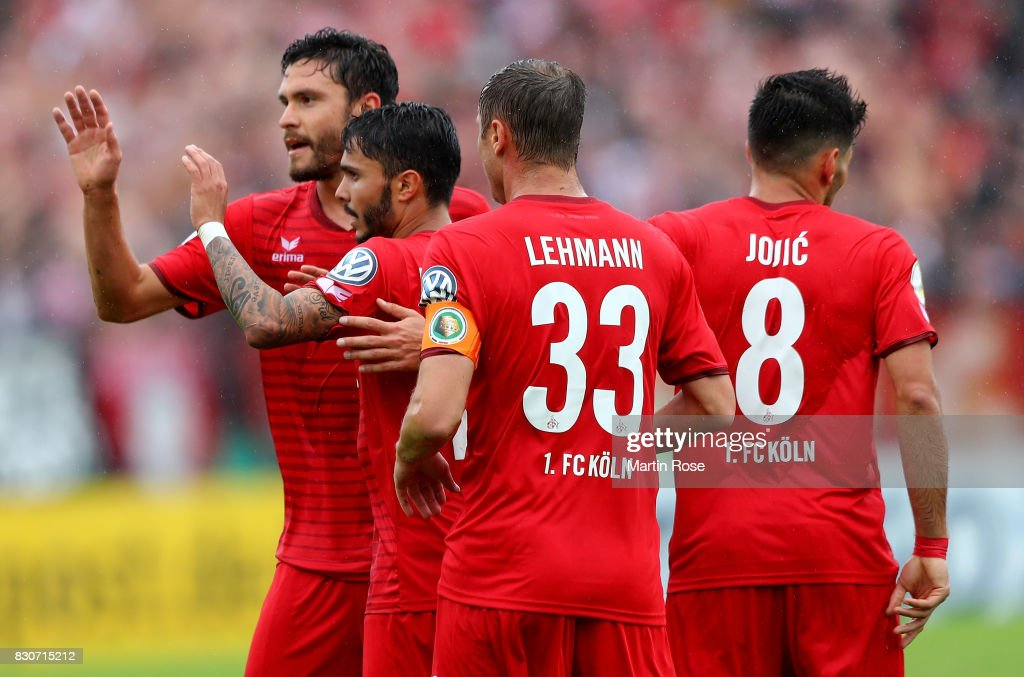 Leonardo Bittencourt (C) of Koeln celebrate with his team mates after he scores the opening goal during the DFB Cup first round match between Leher TS and 1. FC Koeln at Nordseestadion on August 12, 2017 in Bremerhaven, Germany.
