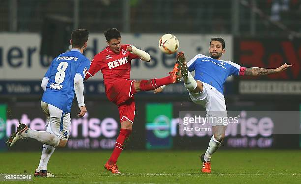 Leonardo Bittencourt of Koeln is challenged by Aytac Sulu of Darmstadt during the Bundesliga match between SV Darmstadt 98 and 1 FC Koeln at...