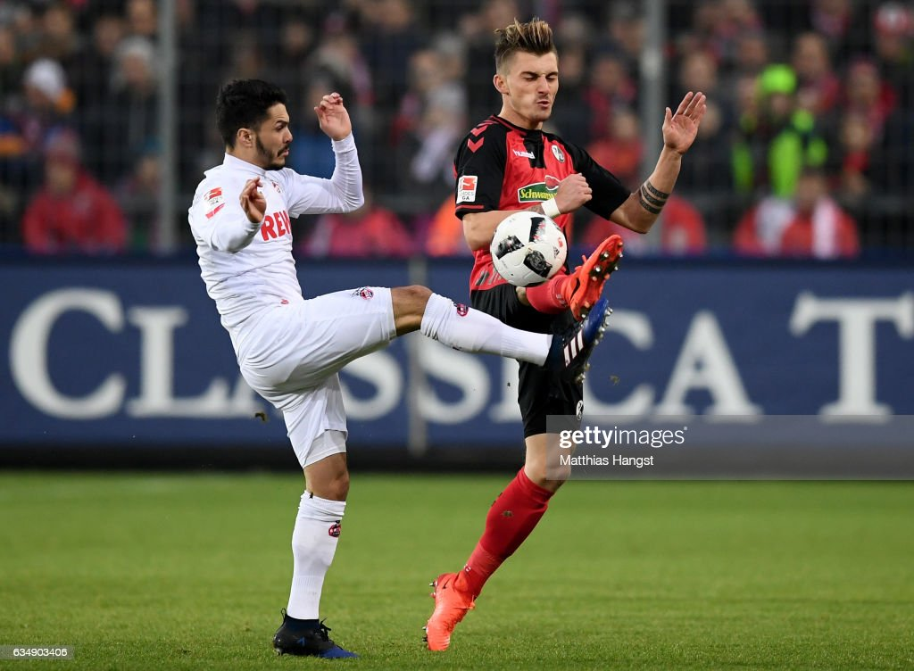 Leonardo Bittencourt of Koeln is challenged by Maximilian Philipp of Freiburg during the Bundesliga match between SC Freiburg and 1. FC Koeln at Schwarzwald-Stadion on February 12, 2017 in Freiburg im Breisgau, Germany.