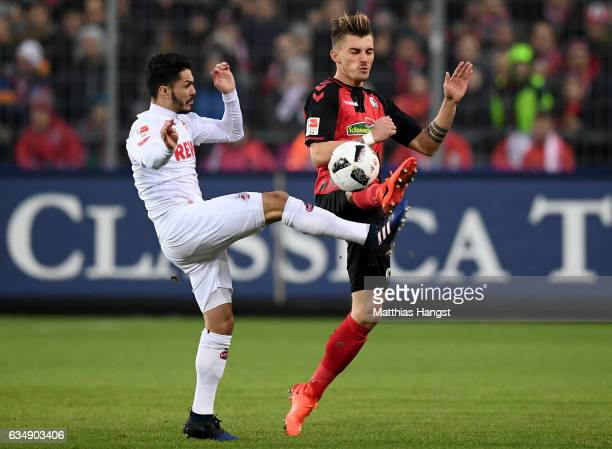 Leonardo Bittencourt of Koeln is challenged by Maximilian Philipp of Freiburg during the Bundesliga match between SC Freiburg and 1 FC Koeln at...