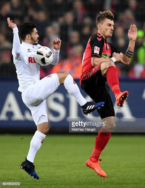 Leonardo Bittencourt of Koeln is challenged by Maximilian Philipp of Freiburg during the Bundesliga match between SC Freiburg and 1 FC Koeln at...