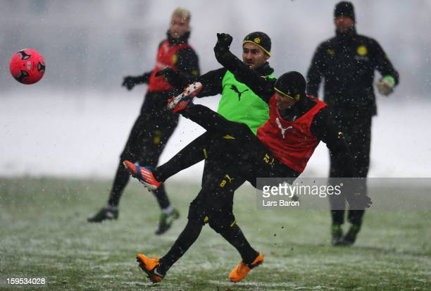 Leonardo Bittencourt scores a goal next to Ilkay Guendogan during a Borussia Dortmund training session on January 15 2013 in Dortmund Germany