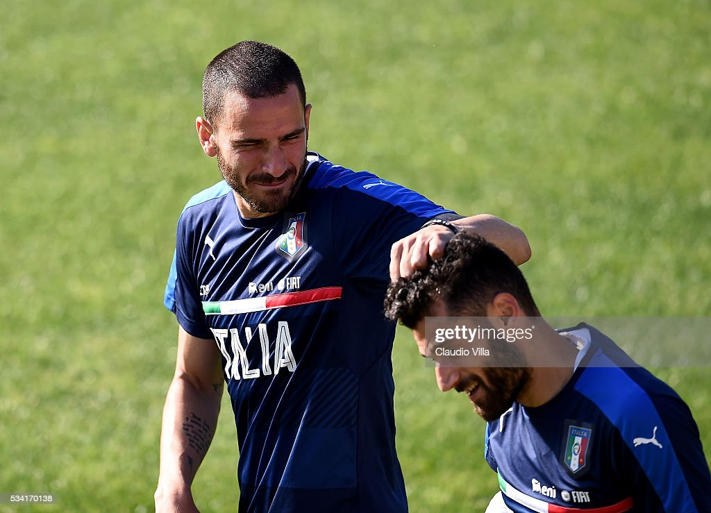 <a gi-track='captionPersonalityLinkClicked' href=/galleries/search?phrase=Leonardo+Bonucci&family=editorial&specificpeople=6166090 ng-click='$event.stopPropagation()'>Leonardo Bonucci</a> (L) and <a gi-track='captionPersonalityLinkClicked' href=/galleries/search?phrase=Antonio+Candreva&family=editorial&specificpeople=4063716 ng-click='$event.stopPropagation()'>Antonio Candreva</a> of Italy jokes during the Italy training session at the club's training ground at Coverciano on May 25, 2016 in Florence, Italy.