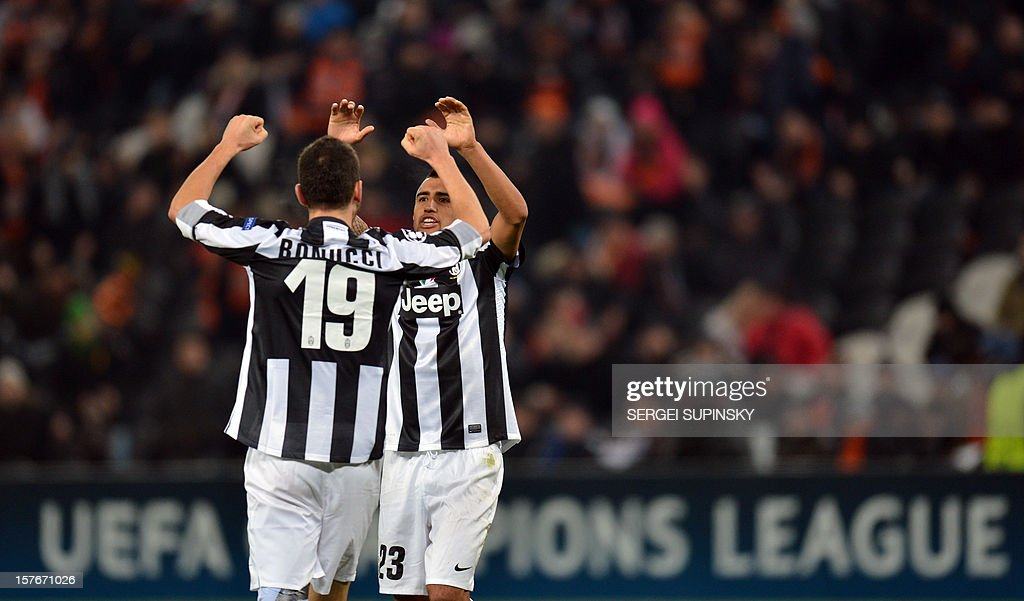 Leonardo Bonucci (L) and Arturo Vidal (R) celebrate their team's victory at the end of the UEFA Champions League football match FC Shakhtar Donetsk vs Juventus Turin in Donetsk on December 5, 2012. Juventus won 1-0. AFP PHOTO/ SERGEI SUPINSKY
