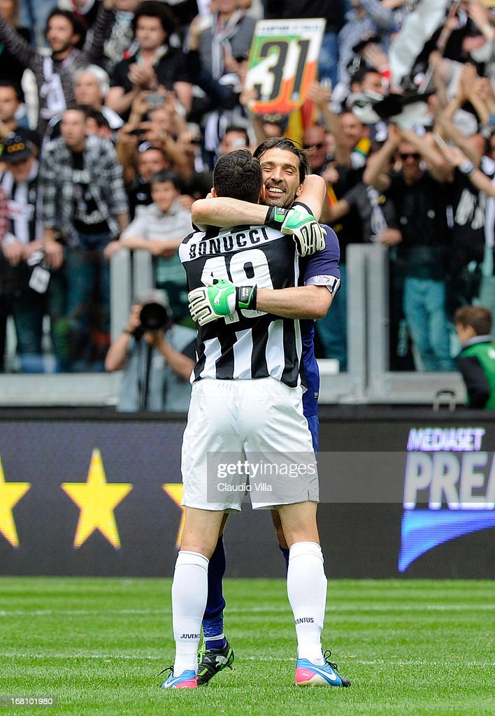 Leonardo Bonucci and Gianluigi Buffon (R) of Juventus FC celebrate at the end of the Serie A match between Juventus and US Citta di Palermo at Juventus Arena on May 5, 2013 in Turin, Italy.