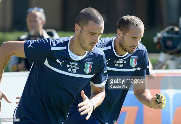 Leonardo Bonucci and Giorgio Chiellini of Italy during a training session at Coverciano on September 3 2013 in Florence Italy