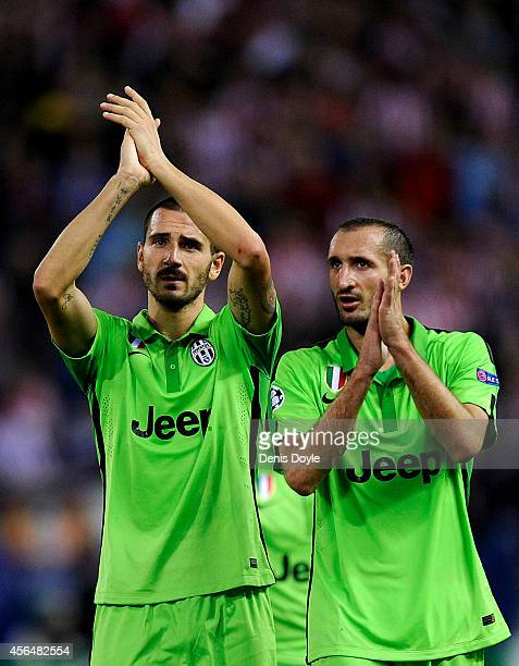Leonardo Bonucci and Giorgio Chiellini of Juventus applaud Juventus fans after losing 10 to Clun Atletico de Madrid during the UEFA Champions League...