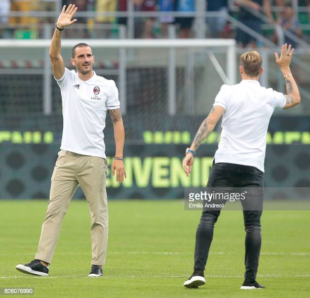 Leonardo Bonucci and Lucas Biglia of AC Milan greet the fans prior to the UEFA Europa League Third Qualifying Round Second Leg match between AC Milan...