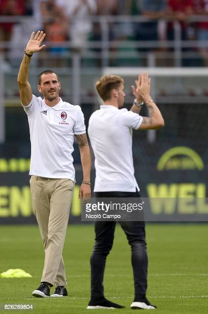Leonardo Bonucci and Lucas Biglia of AC Milan greet the supporters prior to the UEFA Europa League qualifier football match between AC Milan and CSU...