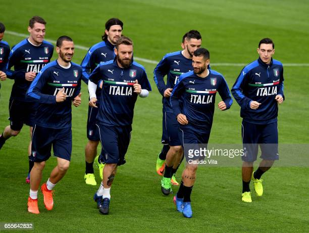 Leonardo Bonucci Daniele De Rossi and Antonio Candreva of Italy chat during the training session at the club's training ground at Coverciano on March...