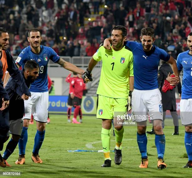 Leonardo Bonucci Gianluigi Buffon and Roberto Gagliardini of Italy celebrate at the end of the FIFA 2018 World Cup Qualifier between Albania and...