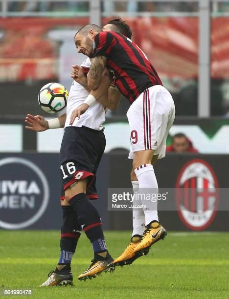 Leonardo Bonucci of AC Milan competes for the ball with Andrej Galabinov of Genoa CFC during the Serie A match between AC Milan and Genoa CFC at...