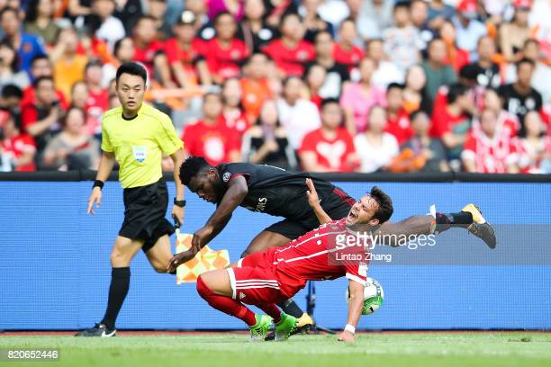 Leonardo Bonucci of AC Milan competes for the ball with Kingsley Coman of FC Bayern during the 2017 International Champions Cup China match between...