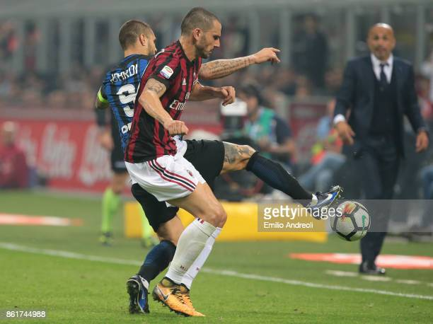 Leonardo Bonucci of AC Milan competes for the ball with Mauro Emanuel Icardi of FC Internazionale Milano during the Serie A match between FC...