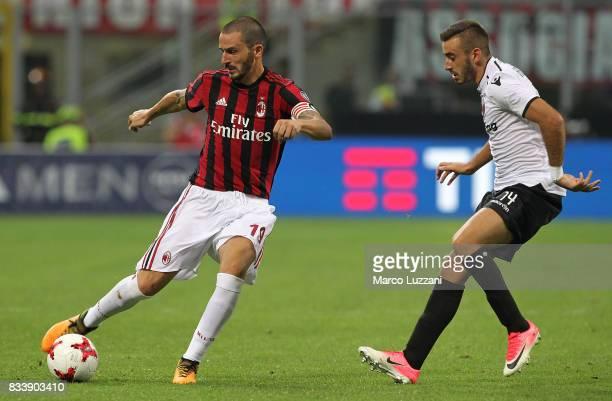 Leonardo Bonucci of AC Milan is challenged by Marjan Radeski of KF Shkendija 79 during the UEFA Europa League Qualifying PlayOffs round first leg...