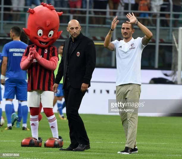 Leonardo Bonucci of AC Milan salutes fans ahead of the UEFA Europa League third qualifying round 2nd leg match between AC Milan and CS U Cairova at...