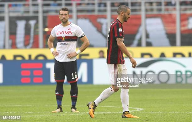 Leonardo Bonucci of AC Milan walks off after getting a red card during the Serie A match between AC Milan and Genoa CFC at Stadio Giuseppe Meazza on...