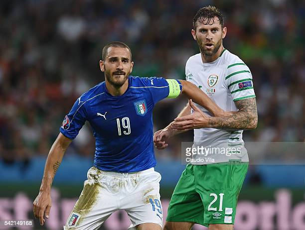 Leonardo Bonucci of Italy and Daryl Murphy of Republic of Ireland tussle during the UEFA EURO 2016 Group E match between Italy and Republic of...
