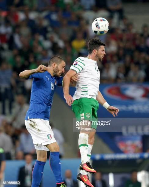 Leonardo Bonucci of Italy and Shane Long of Ireland battle for the ball during the UEFA Euro 2016 Group E match between Italy and Republic of Ireland...