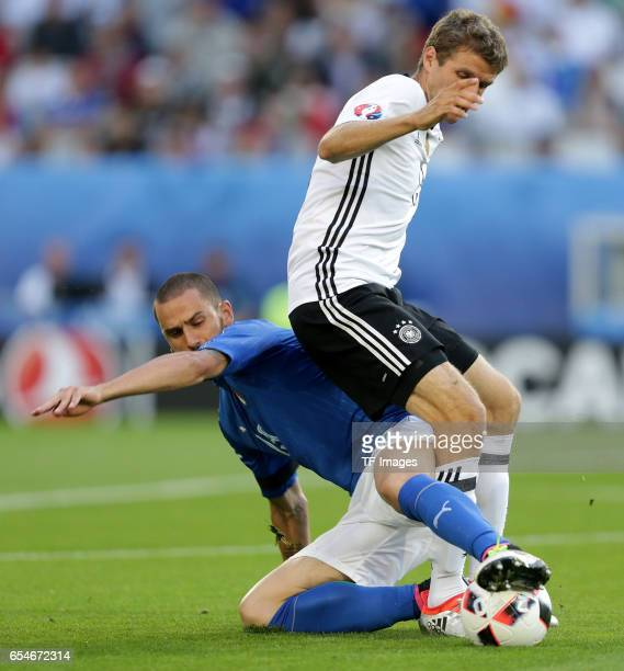 Leonardo Bonucci of Italy and Thomas Mueller of Germany battle for the ball during the UEFA EURO 2016 quarter final match between Germany and Italy...