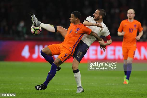 Leonardo Bonucci of Italy challenges Memphis Depay of Netherlands during the international friendly match between Netherlands and Italy at Amsterdam...