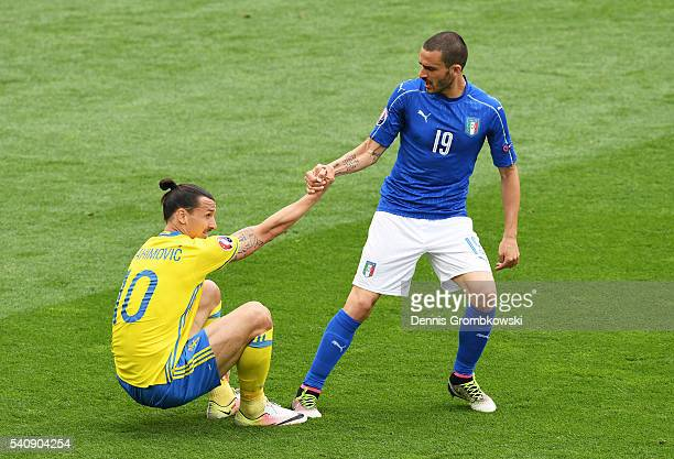 Leonardo Bonucci of Italy gives a helping hand to Zlatan Ibrahimovic of Sweden after a penalty appeal during the UEFA EURO 2016 Group E match between...