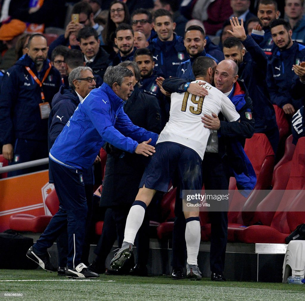 Leonardo Bonucci of Italy scores and runs to the bench to celebrate during the international friendly match between Netherlands and Italy at Amsterdam Arena on March 28, 2017 in Amsterdam, Netherlands.