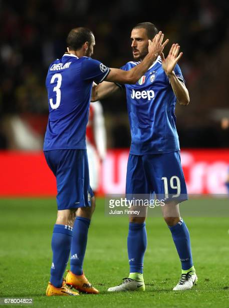 Leonardo Bonucci of Juventus and Giorgio Chiellini of Juventus celebrate during the UEFA Champions League Semi Final first leg match between AS...