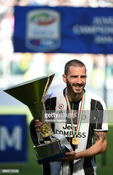 Leonardo Bonucci of Juventus celebrates the Italian Serie A championship with the trophy after winning the Italian Serie A soccer match between...