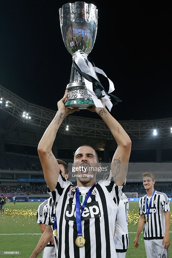Leonardo Bonucci of Juventus celebrates with the trophy after winning the Italian Super Cup final football match between Juventus and Lazio at Shanghai Stadium on August 8, 2015 in Shanghai, China.