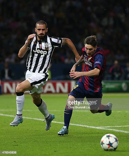 Leonardo Bonucci of Juventus chases Lionel Messi of FC Barcelona during the UEFA Champions League Final match between Juventus and FC Barcelona at...