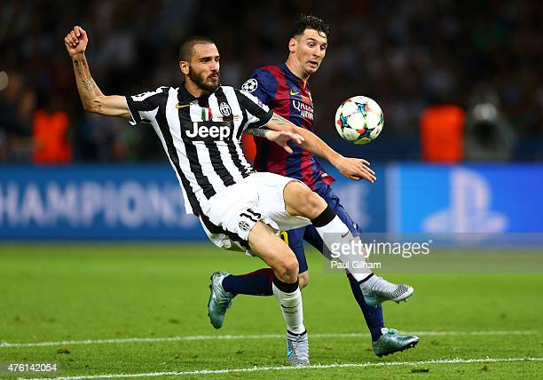 Leonardo Bonucci of Juventus clears the ball from Lionel Messi of Barcelona during the UEFA Champions League Final between Juventus and FC Barcelona...