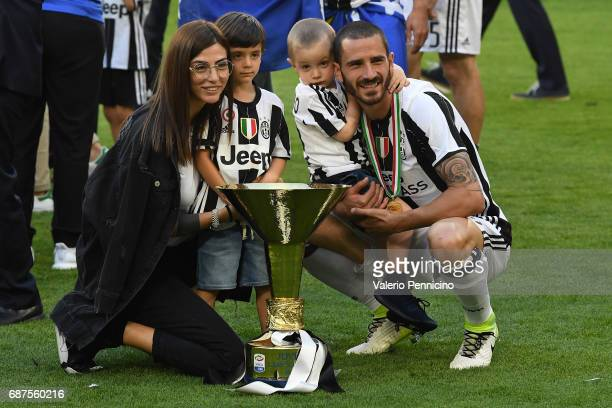 Leonardo Bonucci of Juventus FC and family celebrate with the trophy after the beating FC Crotone 30 to win the Serie A Championships at the end of...