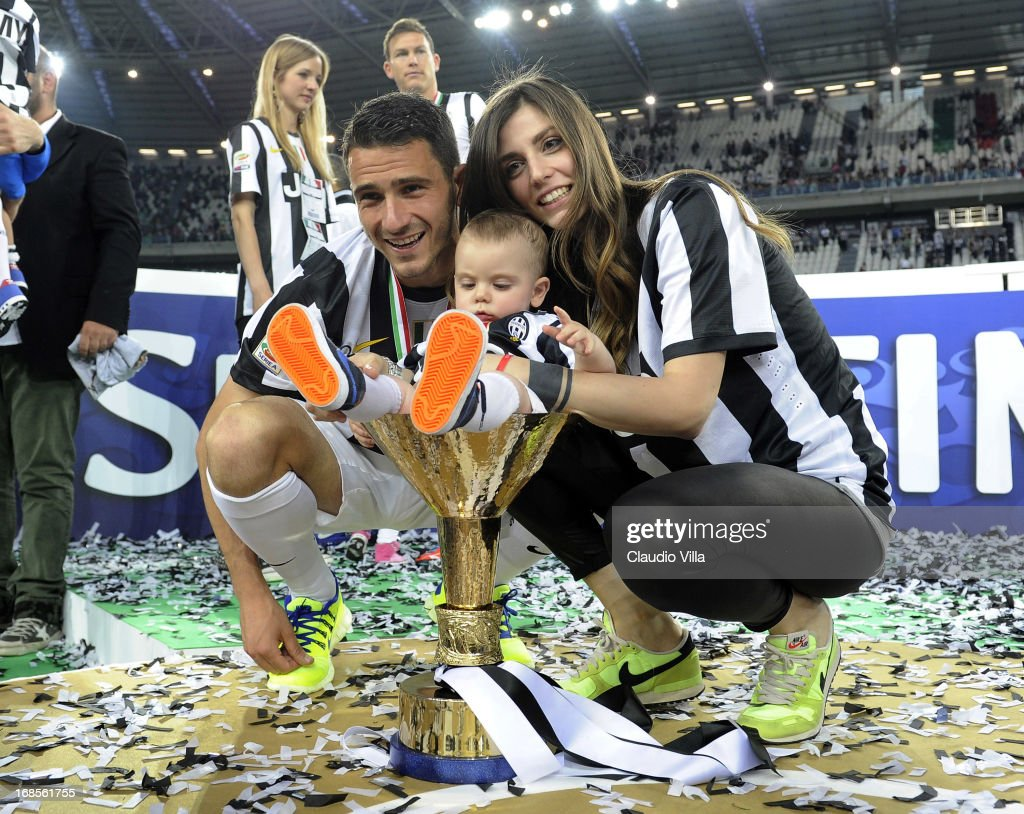 <a gi-track='captionPersonalityLinkClicked' href=/galleries/search?phrase=Leonardo+Bonucci&family=editorial&specificpeople=6166090 ng-click='$event.stopPropagation()'>Leonardo Bonucci</a> of Juventus FC and his family celebrate with the Serie A trophy after the Serie A match between Juventus and Cagliari Calcio at Juventus Arena on May 11, 2013 in Turin, Italy.