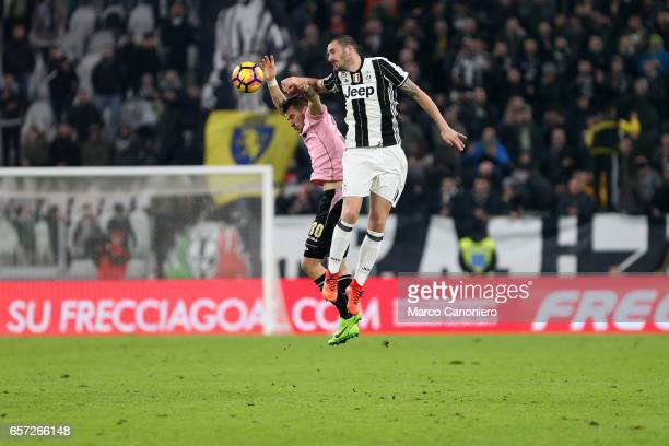 Leonardo Bonucci of Juventus Fc and Ilija Nestorovski of Us Palermo battle for the ball during the Serie A match between Juventus FC and US Palermo...