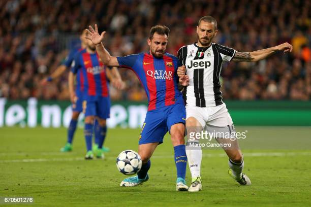 Leonardo Bonucci of Juventus FC and Paco Alcacer of Fc Barcelona battle for the ball during the UEFA Champions League quarter final second leg match...