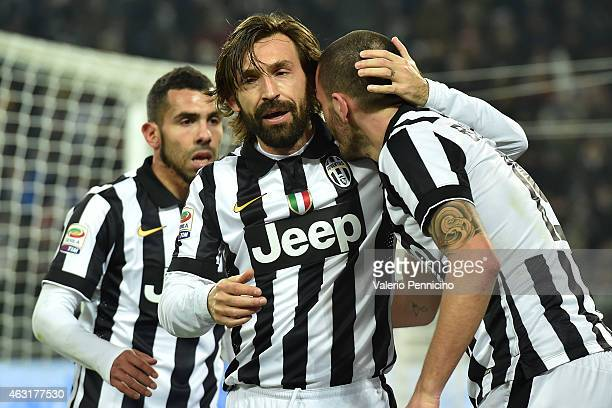 Leonardo Bonucci of Juventus FC celebrates a goal with team mate Andrea Pirlo during the Serie A match between Juventus FC and AC Milan at Juventus...
