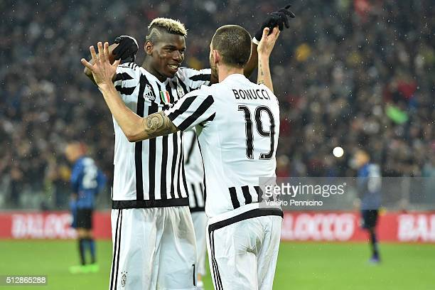 Leonardo Bonucci of Juventus FC celebrates the opening goal with team mate Paul Pogba during the Serie A match between Juventus FC and FC...