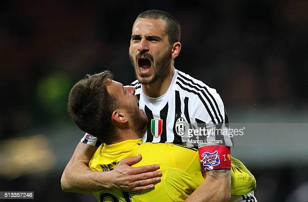 Leonardo Bonucci of Juventus FC celebrates with his teammate Norberto Murara Neto the decisive penalty during the TIM Cup match between FC...