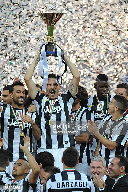 Leonardo Bonucci of Juventus FC celebrates with the Serie A trophy at the end of the Serie A match between Juventus and Cagliari Calcio at Juventus...