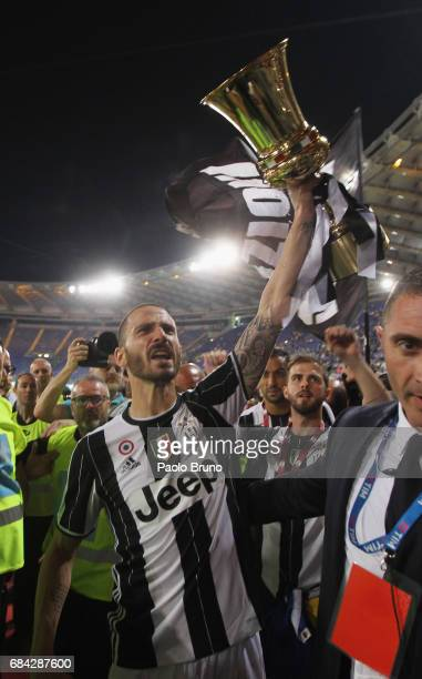 Leonardo Bonucci of Juventus FC celebrates with the trophy after winning the TIM Cup Final match against SS Lazio and Juventus FC at Olimpico Stadium...