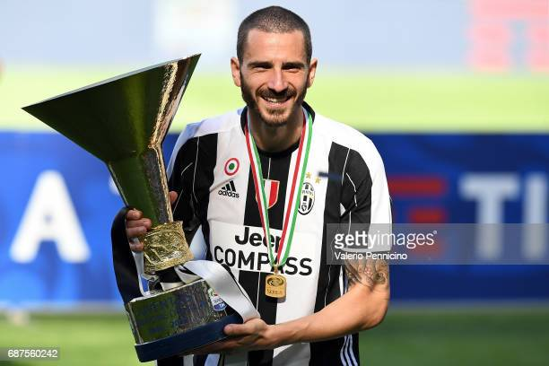 Leonardo Bonucci of Juventus FC celebrates with the trophy after the beating FC Crotone 30 to win the Serie A Championships at the end of the Serie A...