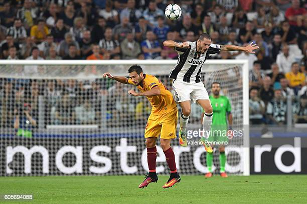 Leonardo Bonucci of Juventus FC clashes with Franco Vazquez of Sevilla FC during the UEFA Champions League Group H match between Juventus FC and...