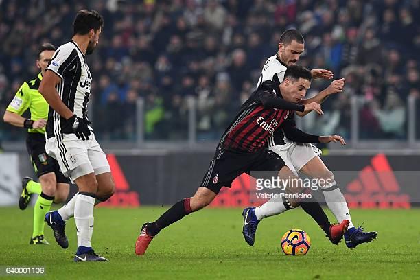 Leonardo Bonucci of Juventus FC competes with Giacomo Bonaventura of AC Milan during the TIM Cup match between Juventus FC and AC Milan at Juventus...