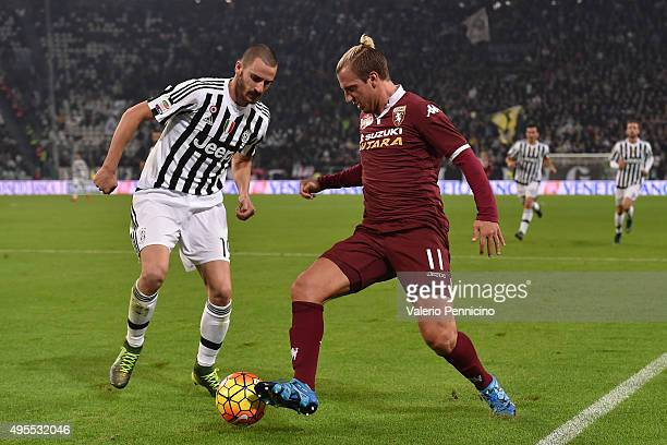 Leonardo Bonucci of Juventus FC competes with Maxi Lopez of Torino FC during the Serie A match between Juventus FC and Torino FC at Juventus Arena on...