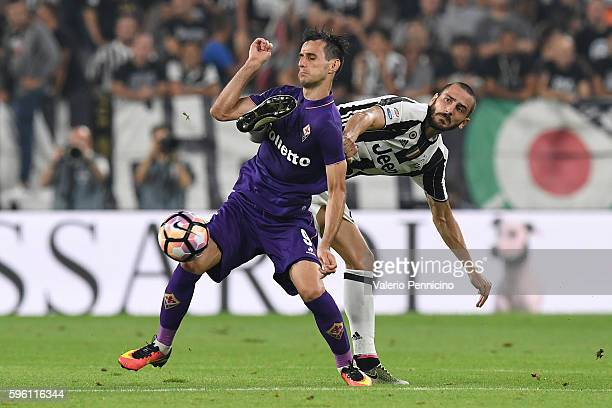 Leonardo Bonucci of Juventus FC competes with Nikola Kalinic of ACF Fiorentina during the Serie A match between Juventus FC and ACF Fiorentina at...