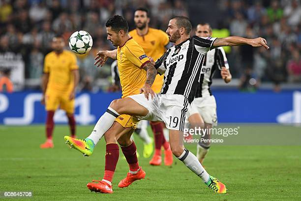 Leonardo Bonucci of Juventus FC competes with Vitolo of Sevilla FC during the UEFA Champions League Group H match between Juventus FC and Sevilla FC...